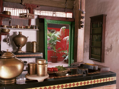 john-henry-claude-wilson-kitchen-area-with-traditional-brass-cooking-utensils-and-samovar-in-restored-traditional-pol-house